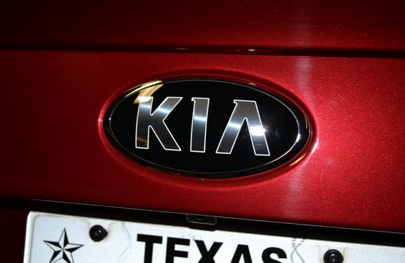 новй знак на kia optima