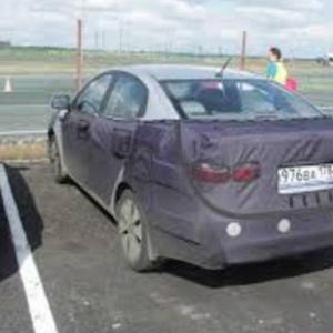 Новая Kia Rio в камуфляже — фотографии с тестов
